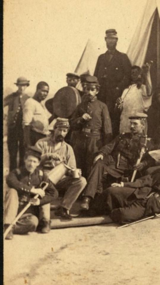 The young man at the far left is Henry Copperthite. Copperthite, who was from New Haven, Connecticut, joined the 79th New York in 1861, and was with them when they were stationed at Georgetown College. After the war Copperthite returned to Georgetown to found the Connecticut Copperthite Pie Company. (The photo––courtesy of a descendant––was probably taken in fall of 1862, during the completion of work on Ft. Marcy, near Chain Bridge.)