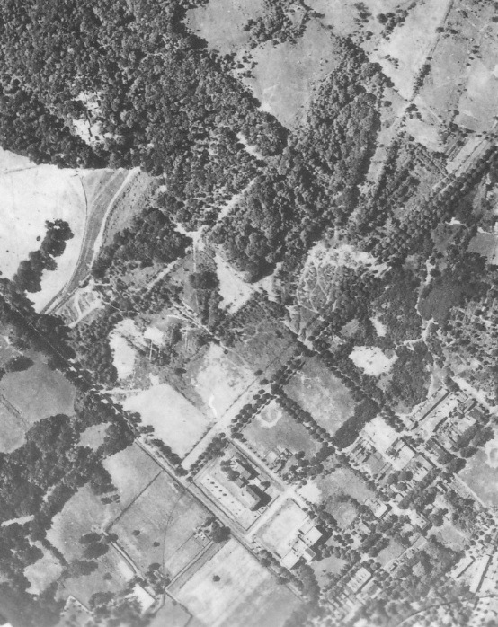 """Burleith, 1922. At right, landscaping for the future """"Hillandale"""". At bottom, the House of the Good Shepherd, and Western High School. There is no sign of a golf course. (The occasional """"doubling"""" of features in this Army Air Corps composite photograph––such as along 37th Street––shows where two aerial photos were merged.)"""