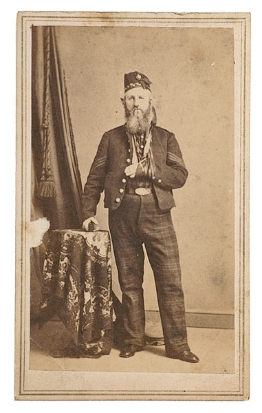 A sergeant of the 79th New York Highlanders, wearing Cameron tartan trews and diced Highland Glengarry, with his arm in a sling. (Cowan's Auctions)