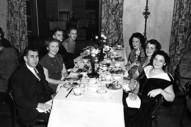 August and Josephine Neuland (far right), and the staff of the Calvert Pastry Shop, on a night out. (Courtesy of a descendant)