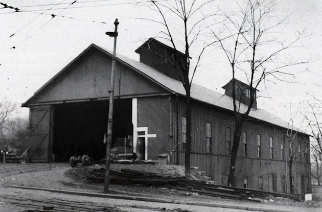 The Georgetown and Tenallytown car barn, on the east side of Wisconsin Avenue at Calvert Street, had a coal fired steam power plant. The photograph was taken in 1909, when the barn was superseded by the Harrison Street Yard. By 1914 it had––in the way of all disused frame buildings in those days––burned down.